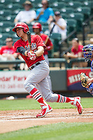 Memphis Redbirds outfielder Stephen Piscotty #33 follows through on his swing during the Pacific Coast League baseball game against the Round Rock Express on April 27, 2014 at the Dell Diamond in Round Rock, Texas. The Express defeated the Redbirds 6-2. (Andrew Woolley/Four Seam Images)