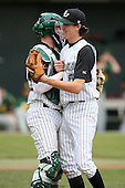 February 21, 2010:  Shortstop/Pitcher Jacob deGrom (5) and Catcher Nick Rickles (9) of the Stetson Hatters during the teams opening series at Melching Field at Conrad Park in DeLand, FL.  Photo By Mike Janes/Four Seam Images