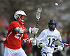 Luke Eschbach #21 of Smithtown East takes a shot at the net during a non-league varsity boys lacrosse game against Massapequa at Burns Park on Saturday, Mar. 26, 2016. Smithtown East won by a score of 17-16.