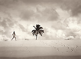 Fiji, young woman in bikini runs on a beach in the Northern Lau Islands (B&W)