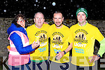 Marese Kearney welcomes home the first three home at the Darkness into Light 5km in aid of Pieta House in Killarney on Saturday morning l-r: Marese Kearney, Jim Hughes Rathmore 2nd, Donal O'Sullivan Killorglin 1st and Stephane Lehane Rathmore 3rd