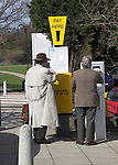 Two men at Pay Here car park ticket machine