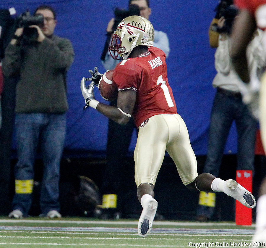 ATLANTA, AG 12/31/10-FSU-SC FB10 CH-Florida State's Mike Harris intercepts a South Carolina pass during first half action Friday at the Chick-fil-A Bowl in Atlanta...COLIN HACKLEY PHOTO