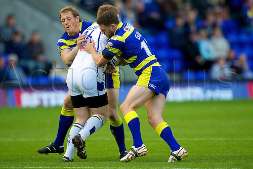 20.05.2011. Warrington Wolves v Swinton Lions. Neil Holland is stopped by Ben Westwood and Simon Grix. Warrington Wolves 112 Swinton Lions 0.