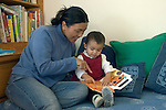 Berkeley CA Nepalese mother and daughter, nineteen-months-old, identifying animals in picture book MR