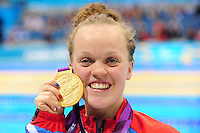 PICTURE BY ALEX BROADWAY /SWPIX.COM - 2012 London Paralympic Games - Day Five - Swimming, Aquatic Centre, Olympic Park, London, England - 03/09/12 - Eleanor Simmonds of Great Britain poses with her Gold medal after the Women's 200m Individual Medley SM6 final.