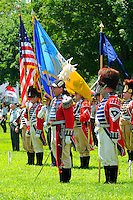 "Soldiers of the First and Second Company, Governor's Foot Guard, New Haven, Connecticut, stand to attention on Norwichtown Green in celebration of Samuel Huntington's birthday. Arguably the first president of the USA,  Huntington was president of Congress when the nation was first designated ""United States"" in the Articles of Confederation."