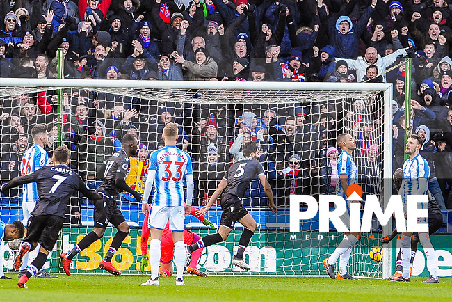 Crystal Palace's defender James Tomkins (5) runs off to celebrate his goal during the EPL - Premier League match between Huddersfield Town and Crystal Palace at the John Smith's Stadium, Huddersfield, England on 17 March 2018. Photo by Stephen Buckley / PRiME Media Images.
