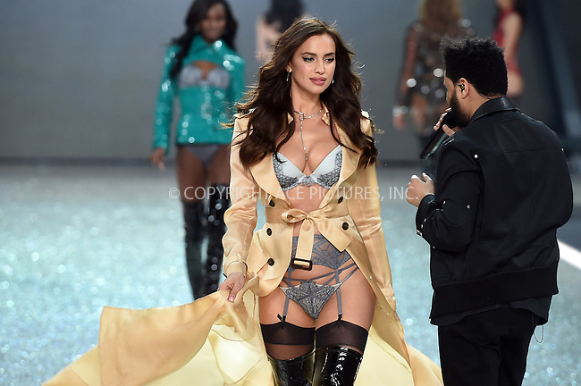 www.acepixs.com<br /> <br /> November 30 2016, New York City<br /> <br /> Irina Shayk walks the runway as The Weeknd performs on the runway during the Victoria's Secret Fashion Show on November 30, 2016 in Paris, France.<br /> <br /> By Line: Alain Benainous/ACE Pictures<br /> <br /> <br /> ACE Pictures Inc<br /> Tel: 6467670430<br /> Email: info@acepixs.com<br /> www.acepixs.com