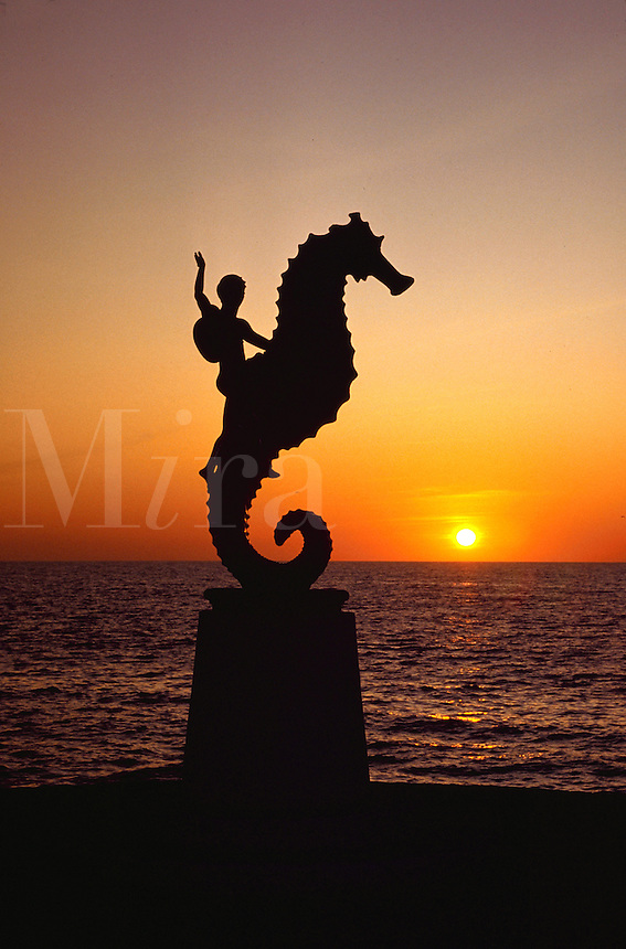 Seahorse statue at sunset on Banderas Bay. Puerto Vallarta, Mexico.