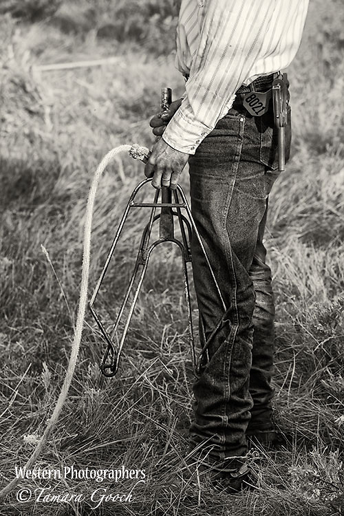 A photo of a rancher holding a fork during a branding Cowboy Photos, riding,roping,horseback