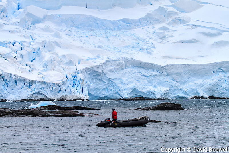 A zodiac cruises through Mikkelsen Harbor on Trinity Island near the Antarctic Peninsula.