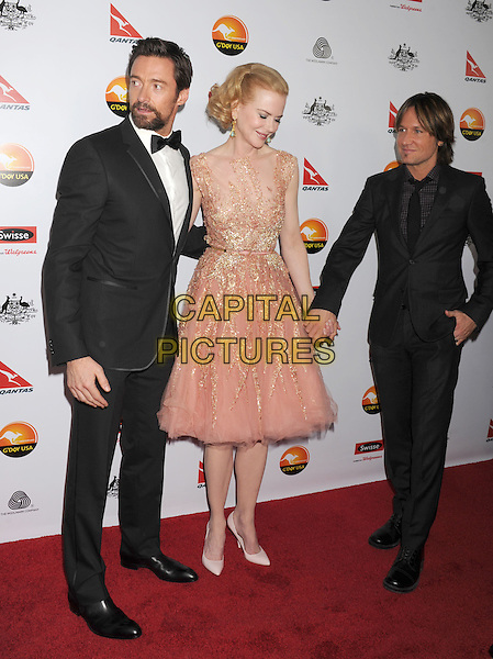 Hugh Jackman, Nicole Kidman, Keith Urban.at The G'Day USA Black Tie Gala held at The JW Marriot at LA Live in Los Angeles, California, USA..January 12th 2013.full length beard facial hair goatee white shirt black suit tie bow tuxedo tux dress pink husband wife couple peach beige nude tulle grey gray beaded holding hands.CAP/ROT/TM.©Tony Michaels/Roth Stock/Capital Pictures