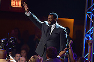 Canton, Ohio - August 6, 2015: Former NFL player Jerome Bettis waves to the audience as he is introduced before donning his gold jacket for the first time during the 2015 Pro Football Hall of Fame enshrinement dinner in Canton, Ohio August 6, 2015. With eight 1,000 plus yard seasons, Bettis was tied for third-best in NFL history and his 13,662 career rushing yards ranked him fifth all-time. (Photo by Don Baxter/Media Images International)