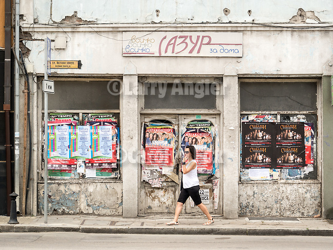 Along the historic streets of Veliko Tarnovo, Bulgaria<br /> <br /> Abandoned shop with posters on the windows