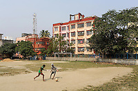 Children playing soccer in residential community in Kolkata.<br />