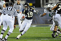 14 November 2009:  FIU running back Kendall Berry (19) carries the ball in the first half as the FIU Golden Panthers defeated the North Texas Mean Green, 35-28, at FIU Stadium in Miami, Florida.