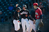 Oregon State Beavers first baseman Zak Taylor (16) congratulates Tyler Malone (7) after scoring a run during a game against the Gonzaga Bulldogs on February 16, 2019 at Surprise Stadium in Surprise, Arizona. Oregon State defeated Gonzaga 9-3. (Zachary Lucy/Four Seam Images)