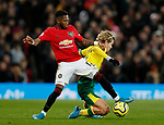 Fred of Manchester United tackles Todd Cantwell of Norwich City during the Premier League match at Old Trafford, Manchester. Picture date: 11th January 2020. Picture credit should read: James Wilson/Sportimage