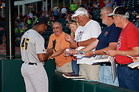 Trenton Thunder pitcher Domingo Acevedo (46) signs autographs prior to a game against the Richmond Flying Squirrels on May 11, 2018 at The Diamond in Richmond, Virginia.  Richmond defeated Trenton 6-1.  (Mike Janes/Four Seam Images)