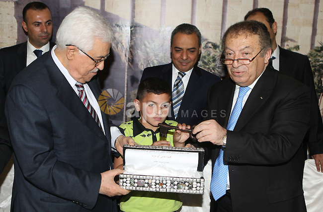 Palestinian President, Mahmoud Abbas (Abu Mazen), participates in breakfast with the group of Palestinian orphans in the West Bank city of Hebron on, Aug. 01, 2012. Photo by Thaer Ganaim
