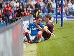 Ryan Hardie slides off the pitch and crashes face first into the trackside LED boards at full speed as Christophe Berra lands a hand