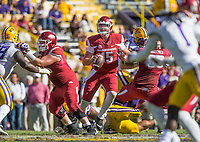 NWA Democrat-Gazette/BEN GOFF @NWABENGOFF<br /> Cole Kelley (15), Arkansas quarterback, looks for a receiver in the fourth quarter against LSU Saturday, Nov. 11, 2017 at Tiger Stadium in Baton Rouge, La.