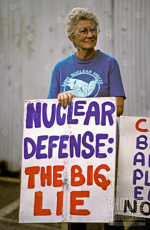 Woman with a sign at the Hilo Protest against nuclear defense