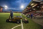 A groundsman on a motorised roller driving on to the pitch at the conclusion of Crewe Alexandra's home game against Leyton Orient (in yellow) in the SkyBet League One at the Alexandra Stadium, Gresty Road, Crewe. The match was won by the visitors from London by 2-1 with two goals on debut by Chris Dagnall, sending Orient to the top of the league. The match was watched by 4830 spectators.