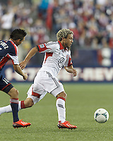 D.C. United midfielder Nick DeLeon (18) on the attack.  In a Major League Soccer (MLS) match, the New England Revolution (blue) tied D.C. United (white), 0-0, at Gillette Stadium on June 8, 2013.
