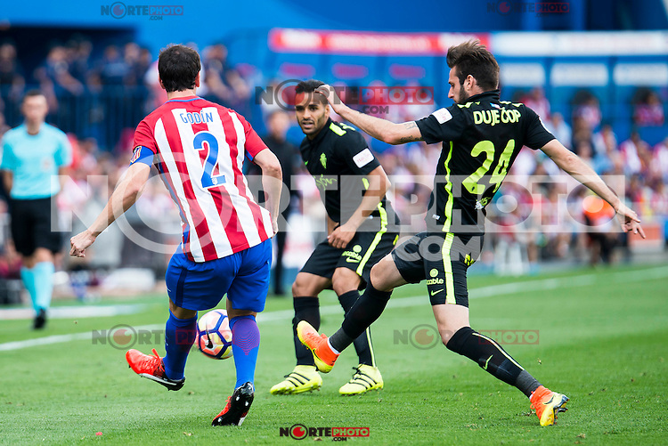 Atletico de Madrid's player Diego Godín and Sporting de Gijon's Douglas and Duje Cop during a match of La Liga Santander at Vicente Calderon Stadium in Madrid. September 17, Spain. 2016. (ALTERPHOTOS/BorjaB.Hojas) /NORTEPHOTO