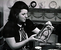 BNPS.co.uk (01202 558833)<br /> Pic: Woolley&Wallis/BNPS<br /> <br /> Avid collector Judith Howard in the 1960's.<br /> <br /> One woman's lifetime collection of French porcelain that filled 'every nook and cranny' of her modest home sold for £373,000 yesterday, over £125,000 over estimate.<br /> <br /> The late Judith Howard's passion for 18th century gallic ceramics saw the walls, shelves and display cabinets adorned with hundreds of plates, dishes and bowls.<br /> <br /> She was well known for having an eye for a bargain, so much so that a 250-year-old plate she bought for £13 at an antiques shop sold for £31,000.<br /> <br /> The item was once part of the 1,735 dinner service set made for French King Louis XV and housed in the Palace of Versailles.