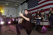 Actor/Entertainer Wayne Newton from Las Vegas, Nevada, performs for the crewmembers during a United Services Organization (USO) show aboard USS Nimitz (CVN 68) on June 19, 2003.  Nimitz Carrier Strike Force and Carrier Air Wing Eleven (CVW-11) are deployed in support of Operation Iraqi Freedom.  Operation Iraqi Freedom is the multi-national coalition effort to liberate the Iraqi people, eliminate Iraq's weapons of mass destruction, and end the regime of Saddam Hussein. .Credit: U.S. Navy via CNP