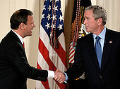 Washington, DC - September 29, 2005 -- Chief Justice of the United States John Glover Roberts, Jr. shakes hands with United States President George W. Bush after taking his oath of office in the East Room of the White House in Washington, D.C. on September 29, 2005.  .Credit: Ron Sachs / CNP