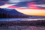 Sunset over Knik River and Chugach Mountains. Palmer Hay Flats State Game Refuge, Alaska, Winter.