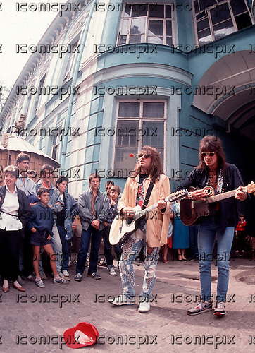 Bon Jovi - Jon Bon Jovi & Richie Sambora - busking in Arbat Street in the centre of Moscow USSR - 11 August 1989.  Photo credit: George Chin/IconicPix