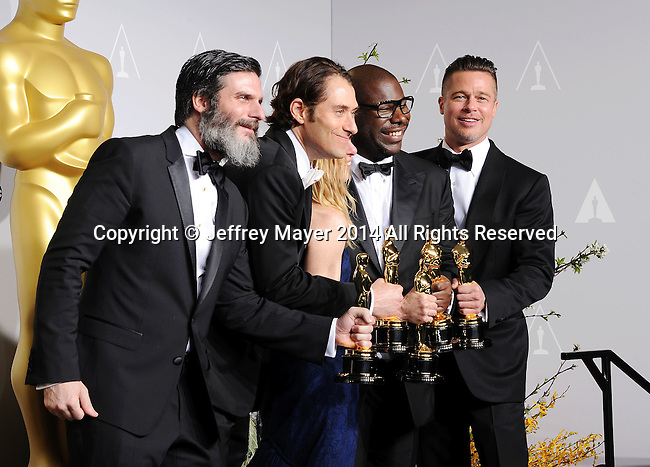 HOLLYWOOD, CA- MARCH 02: (L-R) Producers Anthony Katagas, Jeremy Kleiner, Dede Gardner, Brad Pitt and director Steve McQueen, winners of Best Picture for '12 Years a Slave,' pose in the press room during the 86th Annual Academy Awards at Loews Hollywood Hotel on March 2, 2014 in Hollywood, California.