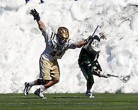 Matt Langan (15) of Loyola sprints past Michael Hirsch (44) of Navy at the Navy-Marine Corp Memorial Stadium in Annapolis, Maryland.   Loyola defeated Navy, 8-7, in overtime.