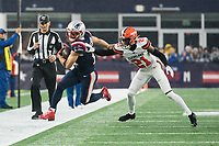 FOXBOROUGH, MA - OCTOBER 27: Cleveland Browns Cornerback Denzel Ward #21 pushes New England Patriots Wide Receiver Julian Edelman #11 out near the sideline during a game between Cleveland Browns and New Enlgand Patriots at Gillettes on October 27, 2019 in Foxborough, Massachusetts.