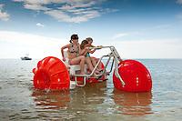 Happy kids on Paddle Bike on Gulf of Mexico, Bonita Springs, Florida, USA. Photo by Debi Pittman Wilkey