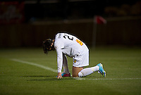 Abby Wambach (20) of the Western NY Flash kneels on the grass after the game at the Maryland SoccerPlex in Boyds, MD.  Washington tied Western NY, 1-1.
