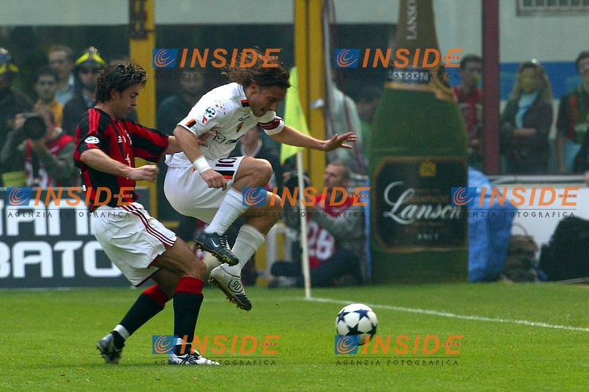 Milano 2/5/2004 Campionato Italiano Serie A - Matchday 32<br /> Milan Roma 1-0 <br /> Milan Campione d'Italia - Milan wins italian championship <br /> Alessandro Costacurta (Milan) tackles Francesco Totti (Roma)