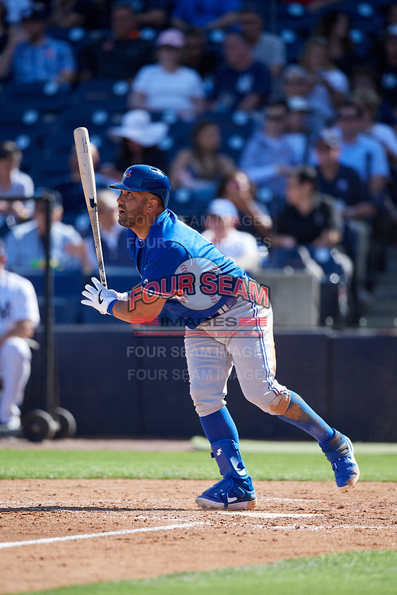 Toronto Blue Jays designated hitter Kendrys Morales (8) follows through on a swing during a Grapefruit League Spring Training game against the New York Yankees on February 25, 2019 at George M. Steinbrenner Field in Tampa, Florida.  Yankees defeated the Blue Jays 3-0.  (Mike Janes/Four Seam Images)