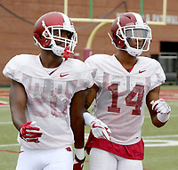 NWA Democrat-Gazette/DAVID GOTTSCHALK   Arkansas Razorback defensive backs De'Andre Coley and Britto Tutt go through drills Tuesday, August 1, 2017, during practice on campus in Fayetteville.