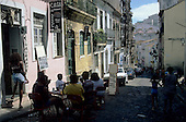 Salvador, Bahia State, Brazil. People sitting at a table outside a cafe bar; Pelhourino.