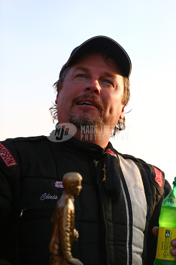 Feb 9, 2014; Pomona, CA, USA; NHRA top alcohol dragster driver Chris Demke celebrates after winning the Winternationals at Auto Club Raceway at Pomona. Mandatory Credit: Mark J. Rebilas-