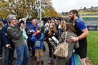 Dave Attwood of Bath Rugby poses for a photo with supporters after the match. Bath Rugby Captain's Run on October 30, 2015 at the Recreation Ground in Bath, England. Photo by: Patrick Khachfe / Onside Images