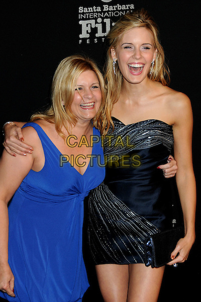 """VALINN DENIG & MAGGIE GRACE .25th Annual Santa Barbara International Film Festival Opening Night Premiere of """"Flying Lessons"""" held at the Arlington Theatre, Santa Barbara, California, USA, .4th February 2010..half length  mother mum mom daughter family blue dress navy strapless silver arm around shoulder smiling mouth open clutch bag .CAP/ADM/BP.©Byron Purvis/AdMedia/Capital Pictures."""