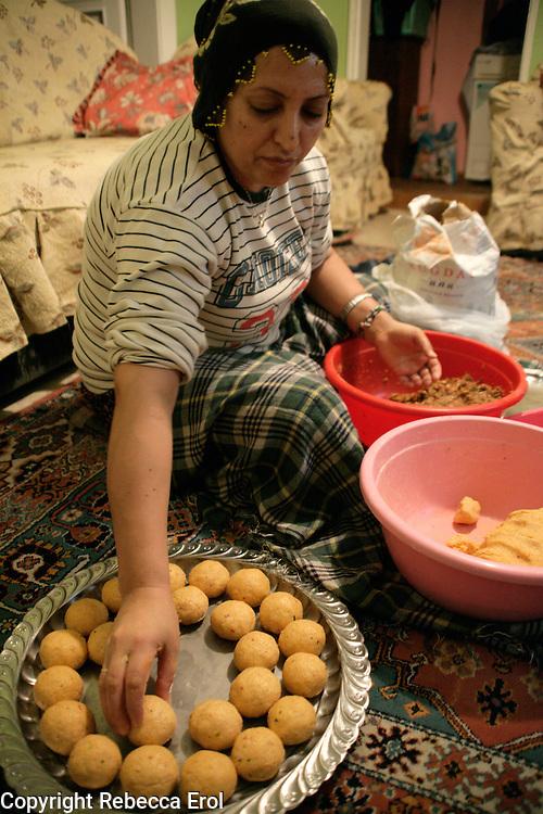Kurdish lady making icli kofte at home, Istanbul, Turkey