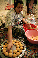 Kurdish lady making icli kofte at home, Istanbul, Turkey